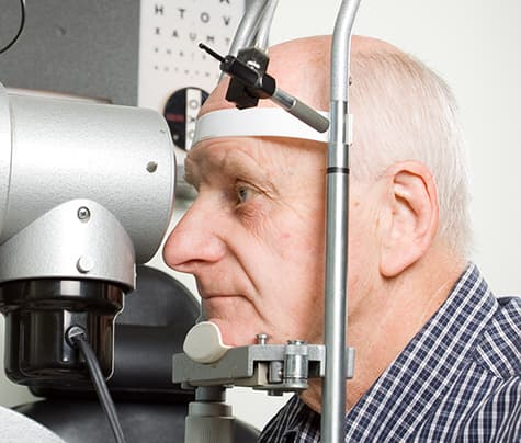 Older man gettting eyes examined